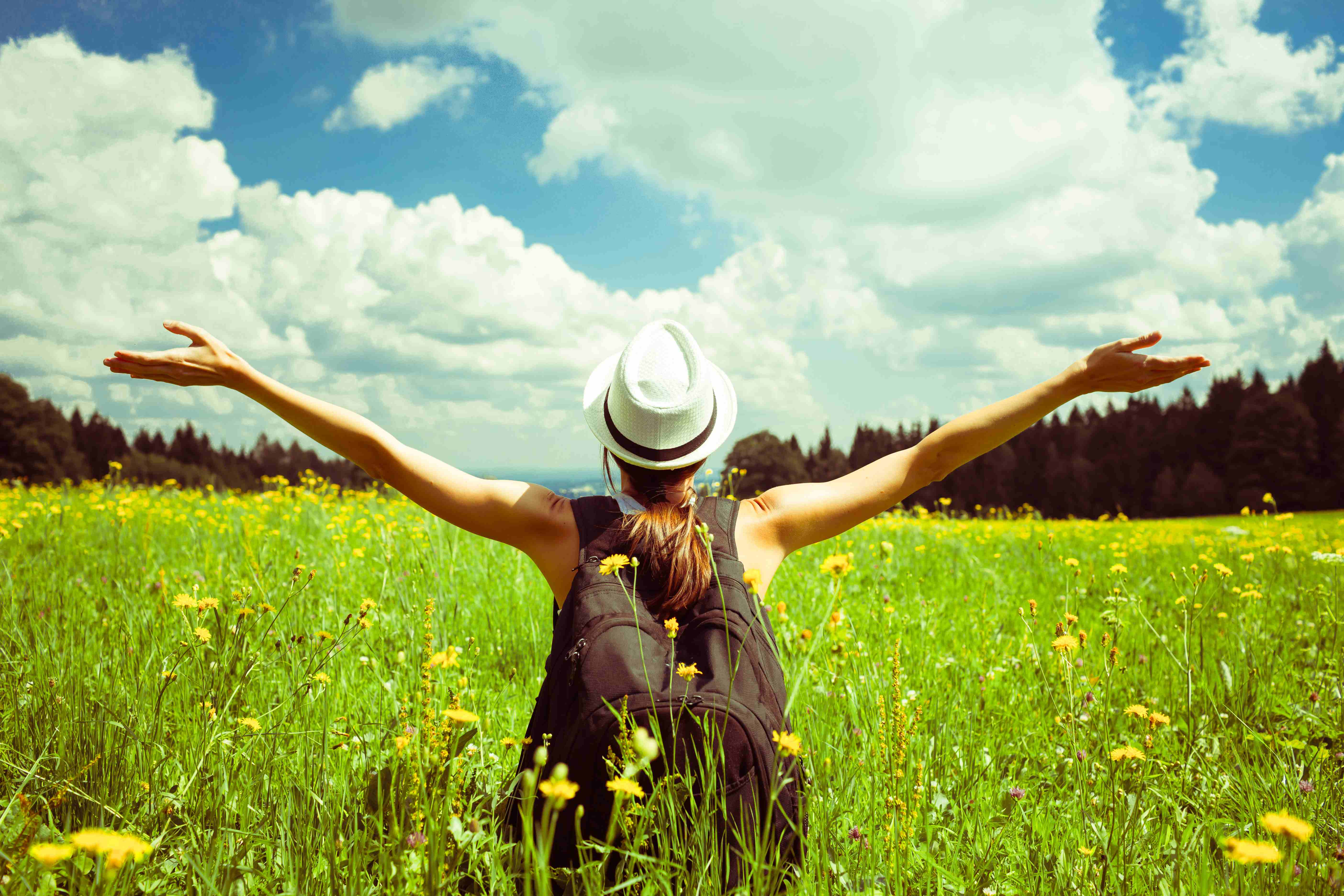 field-woman-arms-raised-adobestock_101081487-compressed